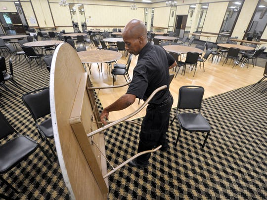 Phil Carn tears downs and sets up in one of the banquet rooms of the Wyndham Garden hotel in West Manchester Township. The Wyndham Garden is one of a number of York County hotels and event venues expecting to pick up business as a result of the Yorktowne Hotel closing for two years for renovations.
