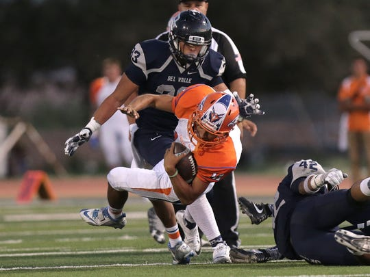 Canutillo running back Aaron Moya lunges forward for