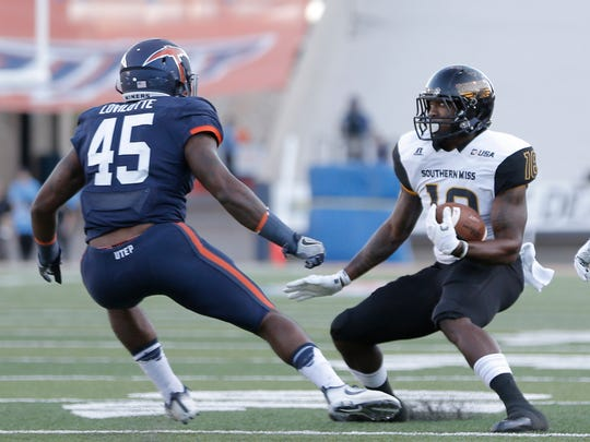 Southern Miss receiver Korey Robertson tries to evade
