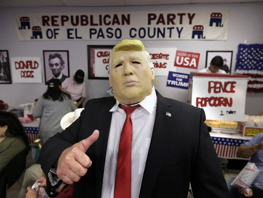 A Donald Trump impersonator works the room during the