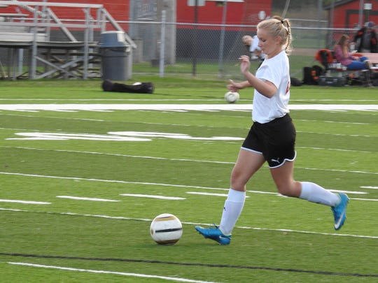 Mid fielder Ashley Roahrig warms up before the game against Ridgewood on Monday night.