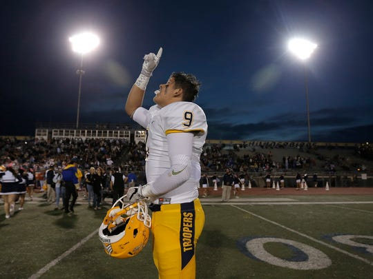 Eastwood linebacker Jake Hernandez prays prior to Friday's