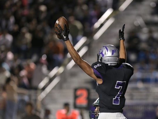 Franklin receiver Luis Baca signals touchdown Friday against Montwood.