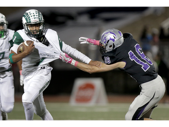 Montwood quarterack Andrew Fernandez takes off on a
