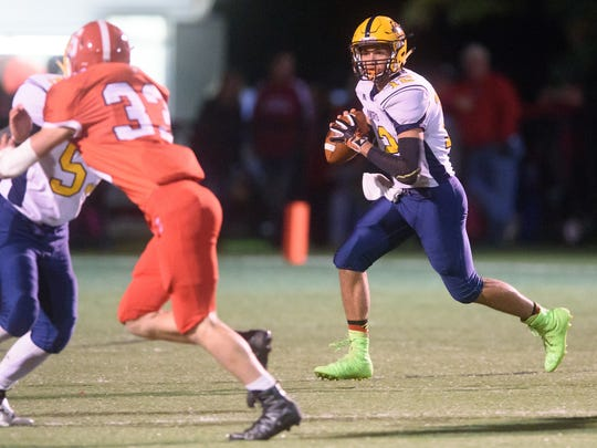 Eastern York quarterback Seth Bernstein (12) rolls out to pass against Susquehannock during a YAIAA football game on Friday, Oct. 14, 2016.