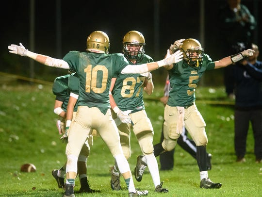 York Catholic's Riley Brennan (87) celebrates a touchdown