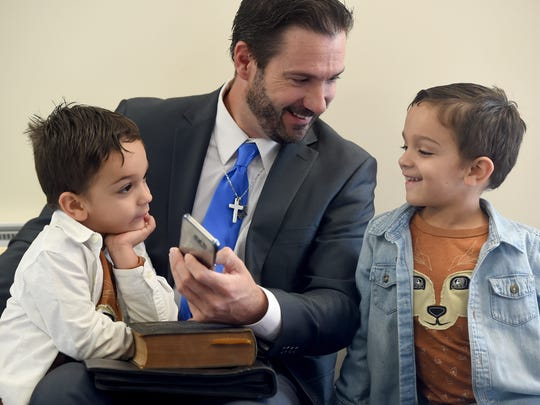 """He has wanted to be mayor since he was a little boy,"" said Frederick Mauck, the father of Shawn Mauck, seen here playing with his twin 3-year-old sons William and Dominick, before he was sworn in as the new mayor of West York."