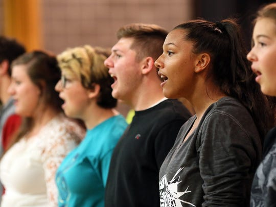 "River View High School students rehearse for ""Rock This Town,"" slated to start at 7 p. m. Saturday in the high school auditorium. The performance will combine the junior and high school choirs to perform popular songs from the 1980s."