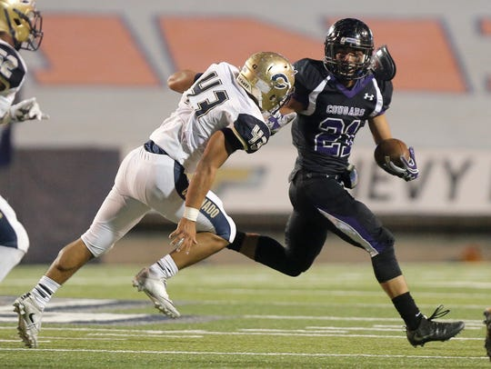Franklin running back Seth Dominquez is chased throught
