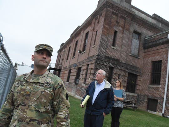 """""""It looks like a castle,"""" says Maj. Adam Bickford, left,  of the Pennsylvania National Guard Armory of the 103-year-old building located on North George Street."""