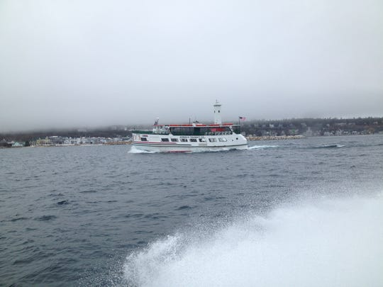 An Arnold Transit ferry leaves Mackinac Island in 2014.