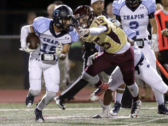 Chapin receiver Mikey Lial runs past Andress linebacker