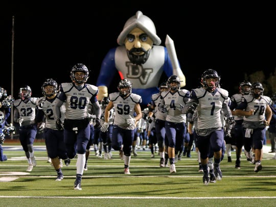 Del Valle takes the field in the second half of their bi-district game Thursday against Chapin at Conquest Stadium.