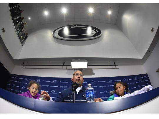 Penn State head coach James Franklin is joined by his daughters in the press conference after the Lions defeated Michigan State to advance to the Big Ten Championship Game.