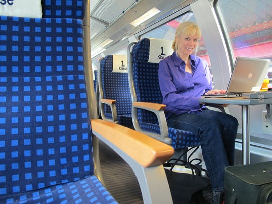 Detroit Free Press reporter Ellen working on a train between Munich and Salzburg in 2011. She was travel writer from 2003 to 2016.