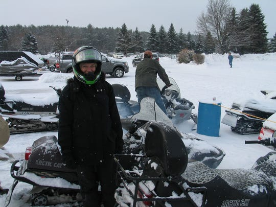 Detroit Free Press reporter Ellen Creager in a snomobile suit in Cadillac, Michigan, doing a story in 2010. She was travel writer from 2003 to 2016.
