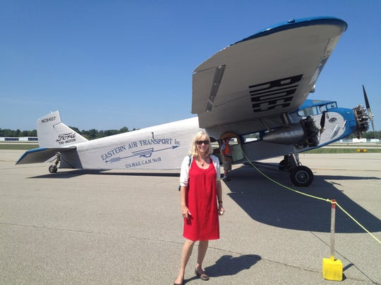 Detroit Free Press reporter Ellen Creager reporting at the Oakland (Pontiac) airport in 2012. She was travel writer from 2003 to 2016.