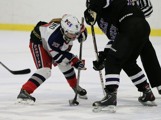 Winning a faceoff during a recent game at Arctic Edge