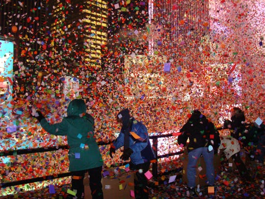 A blizzard of confetti is dispersed at a New Year's Eve celebration in New York's Time Square.
