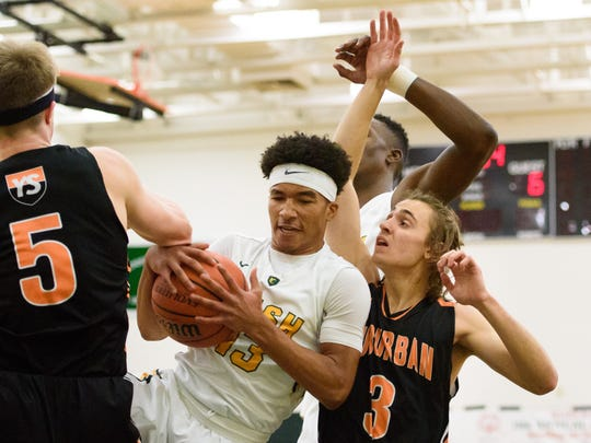 D'Andre Davis and York Catholic are rolling through the regular season. Their toughest task in district could come against the only team they've lost to: No. 2 Trinity,.