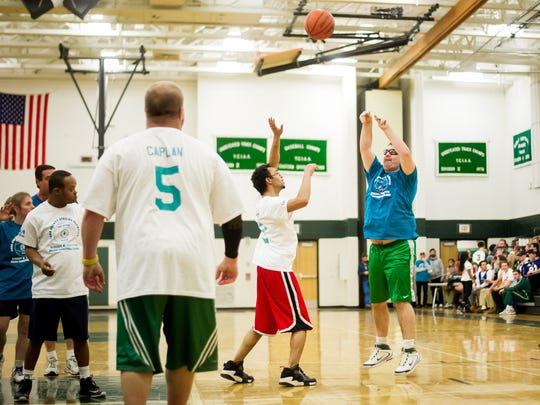 Wyatt Bowman unleashes a shot for the Teal Team during the Special Olympics showcase game before York Catholic and York Suburban tip off during the 28th-annual Robert H. Griffith Holiday Classic at the York County School of Technology on Wednesday, Dec. 28, 2016. The tournament benefits York County Special Olympics.