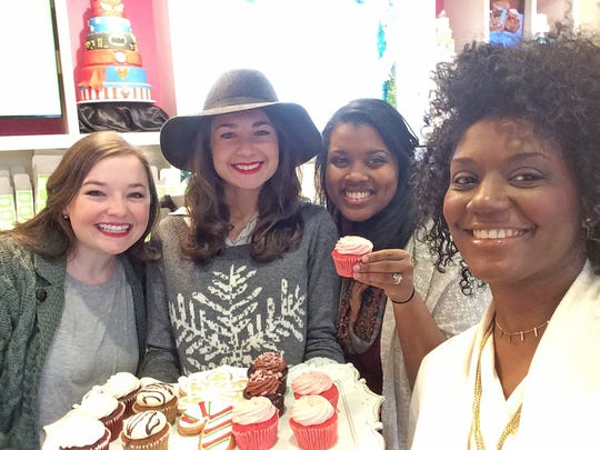 The startup staff of the new magazine, Hey GIRL! Online, take a much-needed cupcake break after a photo shoot at Frost Bake Shop in Collierville.