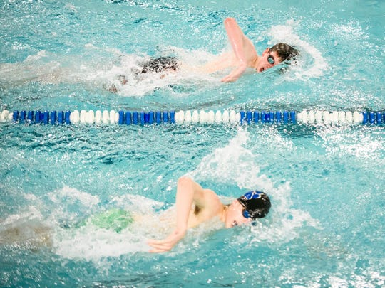Central York's Patrick O'Neill, top, edges out Dallastown's Mark O'Rourke, bottom, in the 500-yard freestyle during a dual meet between Dallastown and Central York at Dallastown Area High School on Thursday, Jan. 5, 2017. Dallastown swept with boys and girls team wins.