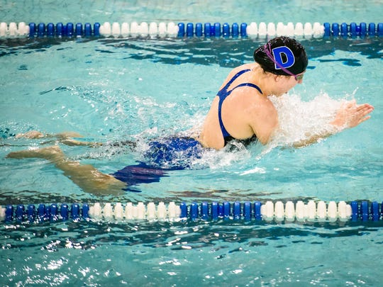 Dallastown's Jena Woods swims to a victory in the 100-yard breaststroke during a dual meet between Dallastown and Central York at Dallastown Area High School on Thursday, Jan. 5, 2017. Dallastown swept with boys and girls team wins.