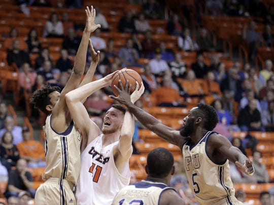 UTEP's Matt Willms shoots while double teamed by a pair of FIU defenders Thursday at the Don Haskins Center.
