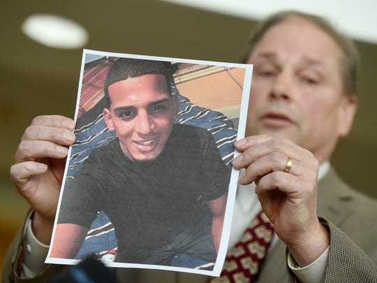 """""""I feel as though, he was a target. This was not a random act of violence,"""" said West Manchester Township Detective Sgt. Jeff Snell, seen here holding a photograph of murder victim Juan DeJesus. The body of DeJesus was discovered Jan. 5 with multiple bullet holes in it and on fire."""