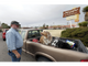 Mike Waldo checks on his dogs as he waits in line at