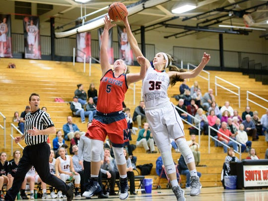 South Western's Taylor Geiman (35) blocks a shot attempt by New Oxford's Presley Berryhill (5) in a YAIAA girl's basketball game on Wednesday, Jan. 18, 2017. New Oxford won 43-37.