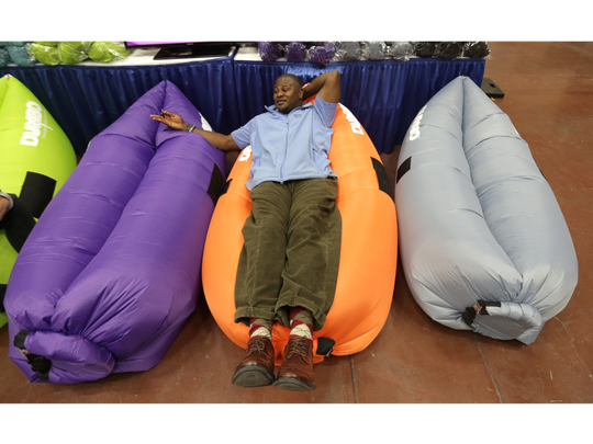 A visitor to the El Paso Spring Home Show tests the Dumbo Lounge Sack in January 2017.