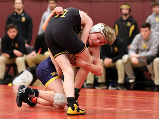 Lancaster freshman Logan Agin competes in the 113 class at the Division I, Region 5 State Wrestling Duals.