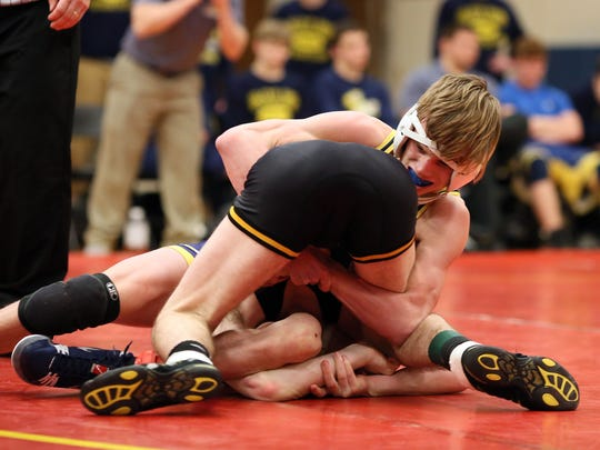 Lancaster freshman Cray Miller wrestles in the 120 class at the Division I, Region 5 State Wrestling Duals.