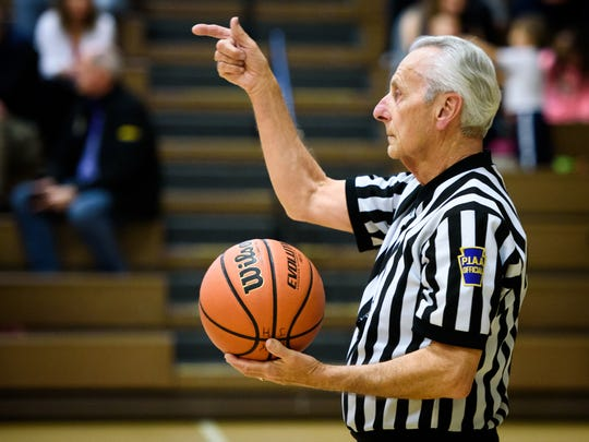 Longtime PIAA referee Don Middleton signals a change of possession after a turnover while officiating a junior high girls' game at Eastern York Middle School as he nears retirement on Wednesday, Feb. 1, 2017. Middleton has officiated basketball and softball for more than 45 years.