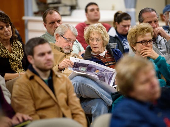 Bill and Patti Conaway of Hellam Township glance over a printed copy of site plans provided by Viridis Medicine during a presentation to the Hellam Township board of supervisors at the Hellam Fire Company Station 21 community hall on Thursday, Feb. 2, 2017. Viridis received approval for its conditional use application for a proposal to build a medical marijuana manufacturing facility in the township.