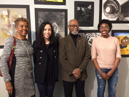 Nedra Clark, left, will be honored at the CGI's awards dinner on Feb. 23. Here she is pictured at the 8th Annual Advanced Placement Studio Art Exhibit, featuring student artwork, in Maplewood in December  2015. With her are, from left, Monique Baltzer, teacher Roger Tucker, and Brezaja Hutcheson.