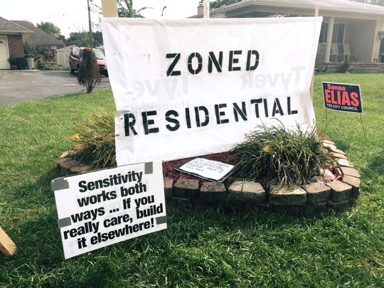 Signs posted on lawns in Sterling Heights opposing the building of a mosque on 15 Mile between Ryan and Mound roads in September 2015.