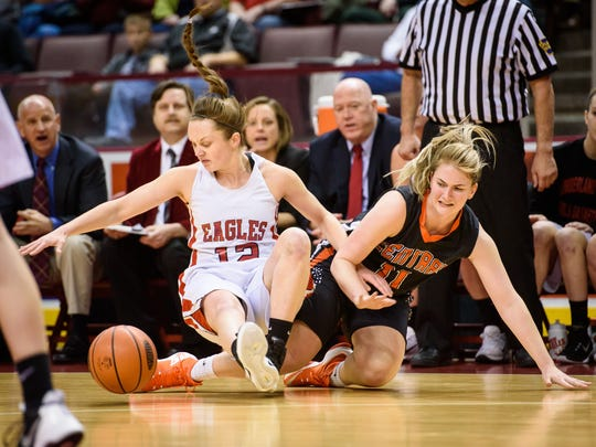 Cumberland Valley's Katie Jekot (12) and Central York's Nikson Valencik (11) get tangled up reaching for a loose ball during a District 3 Class 6A girls basketball semifinal game at the Giant Center on Monday, Feb. 27, 2017. Cumberland Valley won 41-32.