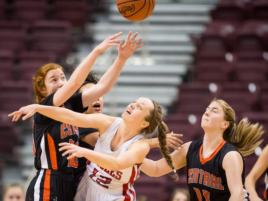 Central York's Emma Saxton (20) passes downcourt under pressure from Cumberland Valley's Katie Jekot (12) during a District 3 Class 6A girls basketball semifinal game at the Giant Center on Monday, Feb. 27, 2017. Cumberland Valley won 41-32.