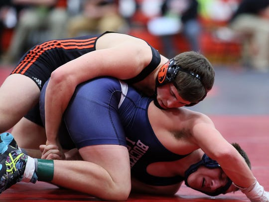 Ridgewood senior Javon Merrill wrestles Buckeye Local sophomore Jack Reese in the 160 pound class during day one of the Division III district wrestling tournament at Coshocton High School.