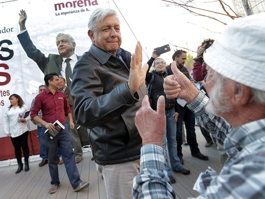 Mexican presidential candidate Andres Manuel Lopez Obrador of the Morena party greets audience members before speaking at San Jacinto Plaza in El Paso Monday.