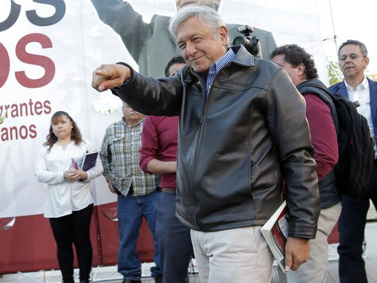Then Mexican presidential candidate Andres Manuel Lopez Obrador of the Morena party greets audience members before speaking at San Jacinto Plaza in El Paso on March 6, 2017.