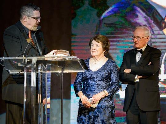 Gregory Miller, left, President and CEO of Penn-Mar Human Services, presents Anne and Robert Kinsley with a Distinguished Humanitarian Award at Penn-Mar's 25th annual gala at Hunt Valley Inn.