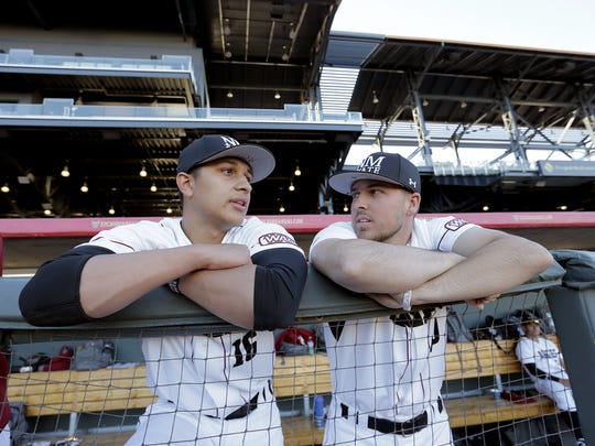 El Pasoans and NMSU baseball players Alex Reyes from El Dorado High School and Mathew Munden from Coronado chat prior to Tuesday's game against UNM at Southwest University Park.