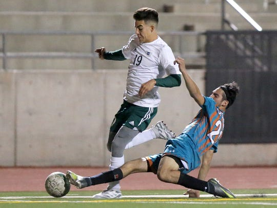 Luis Morales from Pebble Hills High School gets the steal from Montwood's Javier Lara in March at the Socorro Student Activities Complex. SISD officials say the Student Activities Complex no longer meets the needs of its high schools and their sports programs. If the bond is approved, a new facility would be built.