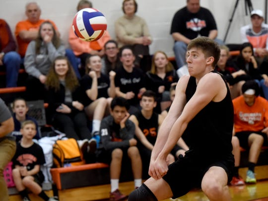 York Suburban's Nate Bowman in action during a volleyball game in 2017.