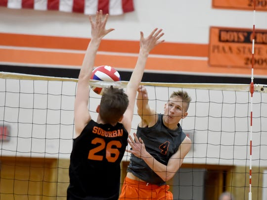 Northeastern's Wyatt Hughes spikes the ball during the bobcats 3-2 victory over York Suburban at York Suburban High School on Tuesday, March 28, 2017.