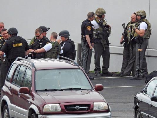 01-COS-041117-officer-shooting-JW.JPG